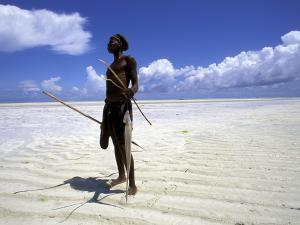 fisherman-on-the-beach-at-low-tide-zanzibar-tanzania